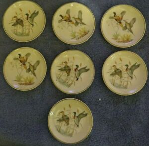 Vintage set of decorative plates E.B. Standish & Co.