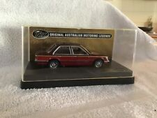 TRAX 1/43 TR61 HOLDEN  VC COMMODORE SL/E SEDAN.TWO TONE RED.