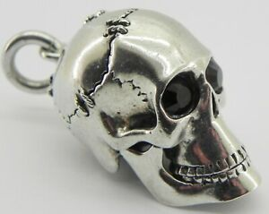 Vintage Solid Silver Memento Mori Skull Pendant with Ruby Eyes.