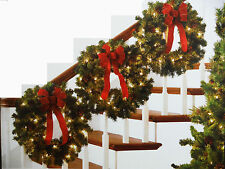 WREATHS.3 PC SET.3 PRE LIT WREATHS W/BOWS AND PINE CONES.INDOOR/OUTDOOR USE