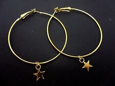 "A PAIR OF SIMPLE GOLD COLOUR 50 MM 2"" HOOP & STAR  EARRINGS. NEW."
