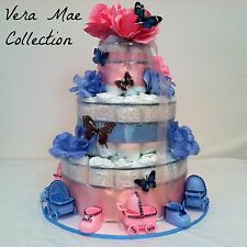 Pink And Blue Diaper Cake For Twins Boy And Girl For A Baby Shower Center Piece