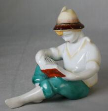 Porzellan Figur Junge liest ein Buch von Hollohaza