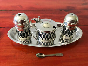 Vintage silver plated 5 piece cruet set with blue lining