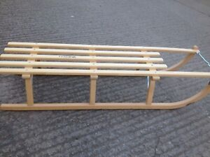 Traditional wooden sledge with steel runners