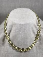Strand of smooth, oval lemon quartz bead with 18k accent beads and clasp