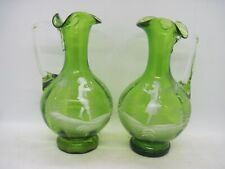 Antique pair Mary Gregory hand made green glass jugs boy & girl cameo decoration