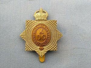 The Kings Dragoon Guards cap badge.
