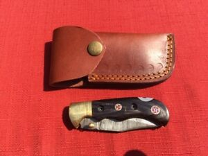 Beautiful Damascus folding blade knife dark bone Stocks leather sheath hand made