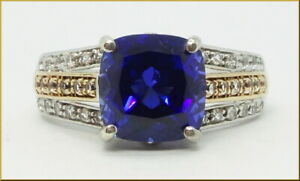 "Lady's authentic ""Lorenzo"" 10K gold & sterling silver blue sapphire & topaz ring"