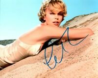 Autographed Charlize Theron signed 8 x 10 photo Nice