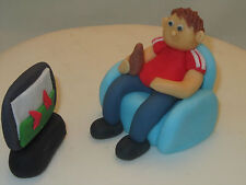 man in chair & TV, hand made figure birthday cake topper, edible