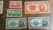 Chinese, German and Japanese currency.