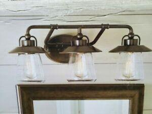 Allen + Roth Bristow 3-Light Vanity Bar Bronze #0809665 24 x8 x 8.75 clear glass