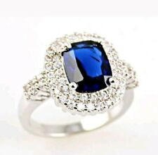 Gorgeous Blue Sapphire surrounded by CZs in a ring of Filled White Gold Size 9