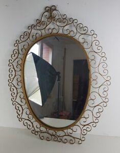 Miroir vintage en fer forgé doré