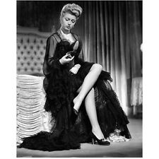 Lana Turner Seated on Bed in Black Dress Looking at Shoe 8 x 10 Inch Photo