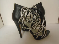 Bebe Womans Black/Silver Leather Gladiator Strappy Open Toe Heels Size 6M