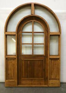 Rustic reclaimed lumber side lites door solid wood story book castle glass door
