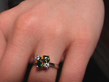 BLACK AUSTRALIAN OPAL RING WITH TWO DIAMONDS SET IN PLATINUM