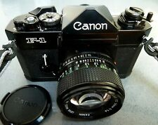 Canon F1 35mm SLR film camera with FD 1.4/50mm lens, cap, case and strap.