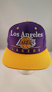 LAKERS PURPLE/GOLD LOGO/TEAM NAME  FLAT VISOR STRUCTURED SNAPBACK CAP BY ADIDAS