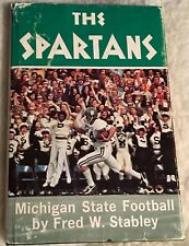 THE SPARTANS HC Book w/DJ Michigan State Football 1975 Fred Stanley MSU Sparty!