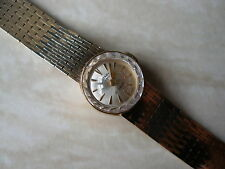 LADYS 9 CARAT GOLD ROTARY WRIST WATCH WITH AN INTEGRAL BRACELET