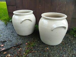 Two French vintage sandstone storage jars