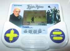La Famiglia Addams Tiger scacciapensieri handled video game videogioco