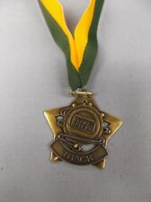gold star track medal with green/yellow drape trophy award