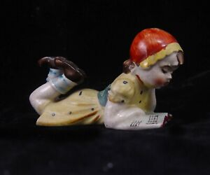 MADE IN OCCUPIED JAPAN SUPINE GIRL SINGING AND READING MUSIC BOOK FIGURINE