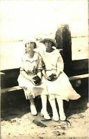 Portrait two ladies at the seaside RPPC postcard antique photograph