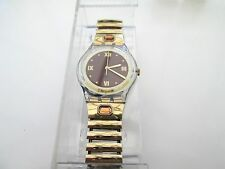 collectors item, 1996  boxed swatch, gold tone,,decent condition flexi strap