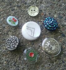 7 vintage glass buttons.