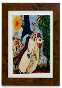 Bride & Groom of The Eiffel Tower Framed Print by Marc Chagall