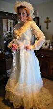 Vintage 1960's Wedding dress, size 12, off white, built-in train, lots of lace.
