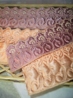 Vintage embossed satin fabric trim on orig. display. Antique mid century deco!