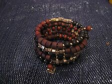 Wonderful chic wrap-around style bracelet with wooden plastic beads brown gold