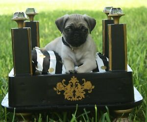 Black and gold dog bed with pillow ( Dog not included)