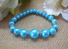 BRACELET, TEAL GLASS PEARLS WITH RHINESTONE SPACERS - 6575