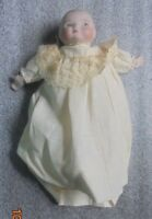 small antique bisque head baby doll in original clothing