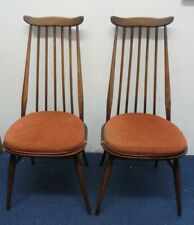 Two Ercol Goldsmith's dining chairs in a dark finish with Ercol cushions