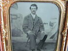 Civil War soldier sitting in front of a military camp backdrop tintype photo