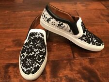 78a9bd63b6 Givenchy Black   White Floral Lace Slip-On Shoes