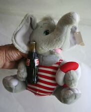 Cute Stuffed Elephant in Striped Bathing Suit with a Life Raft and a Coke
