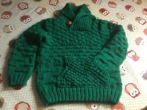 Boys green knitted jumper with shawl collar, brick pattern and front pocket