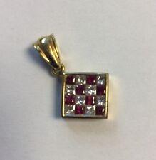 lovely 18kt yellow gold ruby + diamond princess cut pendant