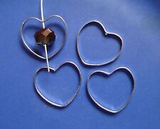 20 HEART SHAPED JUMP RINGS (CLOSED) WITH A 1mm HOLE THE RINGS ARE SIZE 31 x 28mm