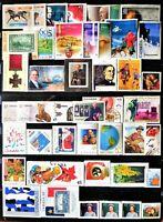 45 uncancelled Canadian postage stamps, no gum, total face value $21.26